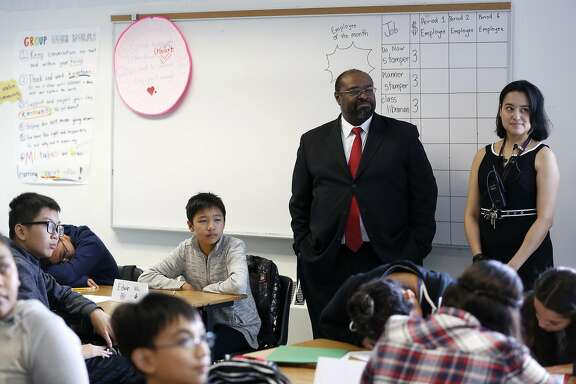 Principal Michael Essien (center) and Assistant Principal Dinora Castro listen as teacher Jennifer Founds describes an activity to her class at Martin Luther King Jr. Academic Middle School in San Francisco, California, on Monday, August 15, 2016.