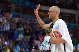 Argentina's shooting guard Manu Ginobili gestures as he leaves the court after losing to USA during a Men's quarterfinal basketball match between USA and Argentina at the Carioca Arena 1 in Rio de Janeiro on August 17, 2016 during the Rio 2016 Olympic Games. / AFP PHOTO / Mark RALSTONMARK RALSTON/AFP/Getty Images