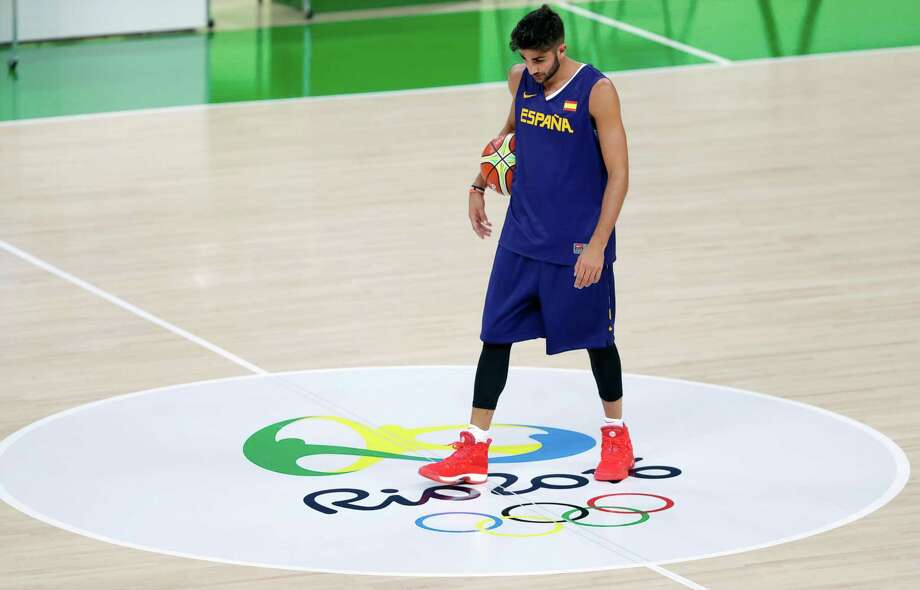 FILE - In this Thursday, Aug. 4, 2016, file photo, Spain's Ricky Rubio walks on the court during basketball practice at the 2016 Summer Olympics in Rio de Janeiro, Brazil. When Rubio lost his mother to cancer this summer, there were times he wondered if he had any basketball left in him. He tells The Associated Press that he thought about pulling out of the Rio Games to be with his family. But he chose to stay, and he has been a catalyst for Spain heading into a semifinal showdown with the United States on Friday, Aug. 19. (AP Photo/Charlie Neibergall, File) Photo: Charlie Neibergall, STF / Copyright 2016 The Associated Press. All rights reserved. This material may not be published, broadcast, rewritten or redistribu