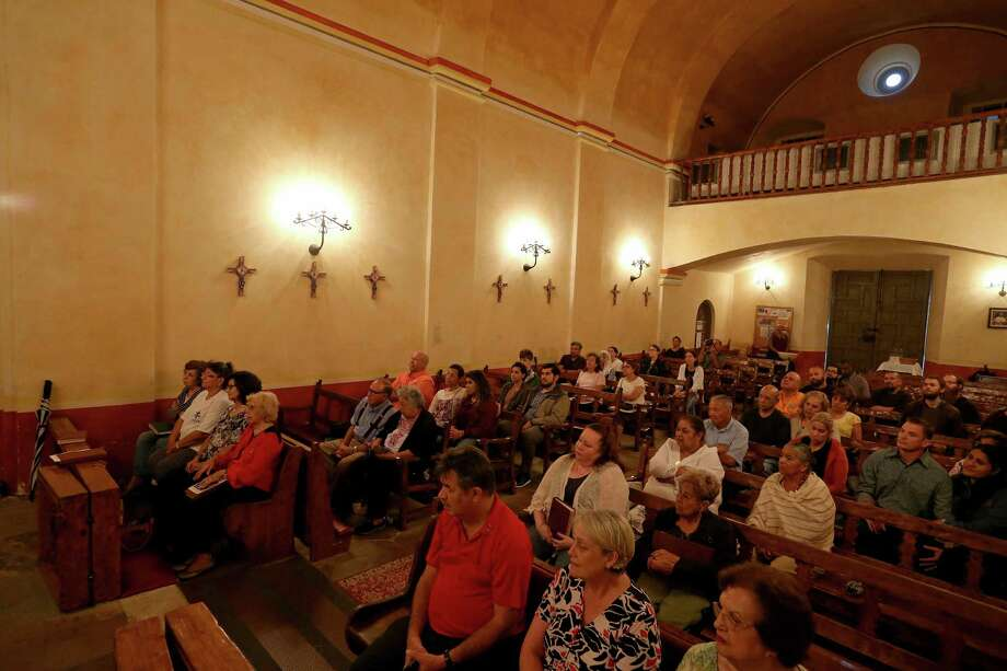 People listen to Father David Garcia (not pictured) discuss the double solar illumination in the church at Mission Concepcion Monday Aug. 15, 2016. The double solar illumination was not visible because of storms. Photo: Edward A. Ornelas, Staff / San Antonio Express-News / © 2016 San Antonio Express-News