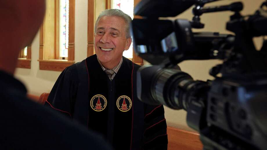 University of the Incarnate Word president Dr. Louis J. Agnese Jr., answers questions from the media before a Conferral Ceremony of Honorary Degrees celebrating his 30th anniversary as UIW president, Monday March 21, 2016 at the Chapel of the Incarnate Word. Agnese, Charles Amato, and Harley Seyedin each received a Doctor of Humane Letters, Honoris Causa the highest honor UIW can confer on an individual. Photo: Edward A. Ornelas, Staff / San Antonio Express-News / © 2016 San Antonio Express-News