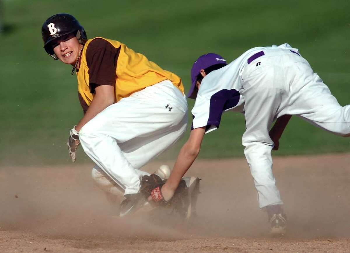 Brendon Hardin of Brunswick School, left, safely steals secondbase in the bottom of the 2nd inning during game against Masters, at Brunswick, Friday, April 30, 2010. Covering for Masters is Justin Voelp.