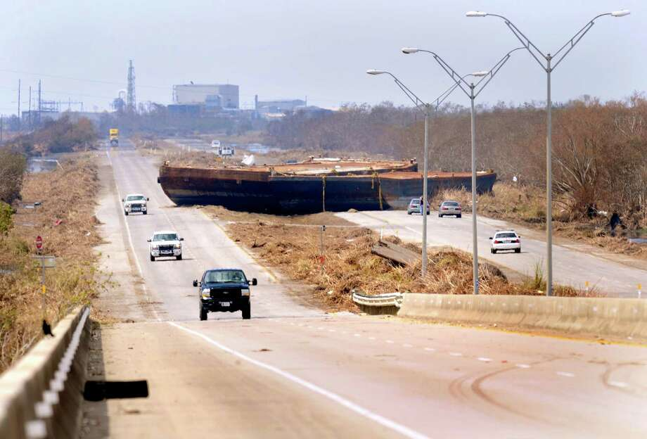 "We ignore the power of a hurricane's storm surge at our peril. The surge from Hurricane Ike, the path of which was not a so-called ""direct hit"" to Houston, carried two huge barges inland and brought them to rest at the foot of the Taylor Bayou bridge, blocking portions of Texas 73 for more than a week. (Beaumont Enterprise file photo.) / Beaumont"