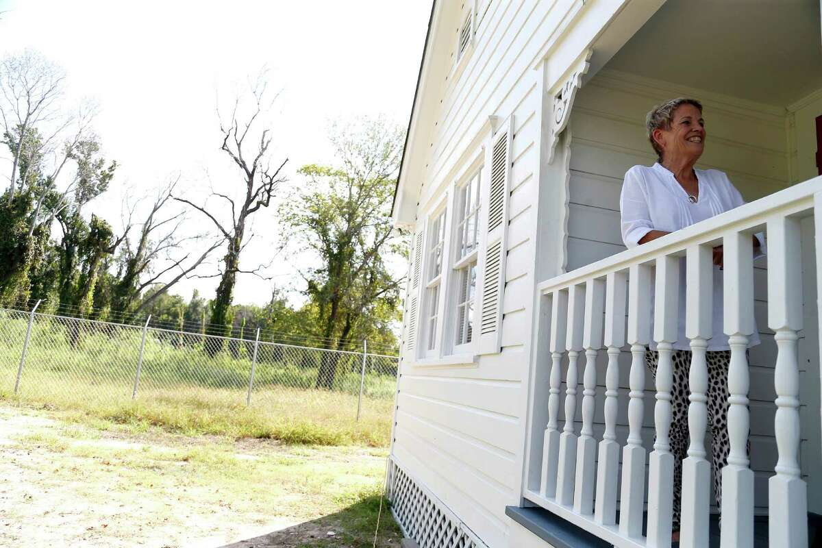 Heidi Eagleton outside of an old Heights-area bungalow that's been restored and moved to Acres Homes where it will be part of a pocket community developed by Eagleton. Photographed on Wednesday, Sept. 30, 2015. ( Karen Warren / Houston Chronicle )