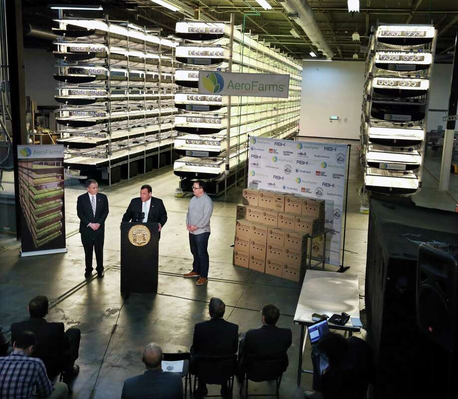 New Jersey Gov. Chris Christie, center at lectern, addresses a gathering at AeroFarms earlier this year. AeroFarms is refurbishing an old steel mill in New Jersey that will soon be the site of the world's largest indoor vertical farm. Photo: Mel Evans, STF / Copyright 2016 The Associated Press. All rights reserved. This material may not be published, broadcast, rewritten or redistribu