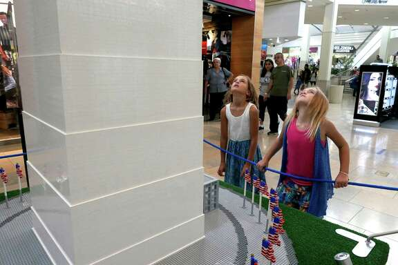 Taylor, right, and Chloe Israel, look up at a Lego model of the Washington Monument which is on display at North Star Mall through September 5. It is part of the Lego Americana Roadshow, a traveling display of large scale Lego models replicating some of America's landmarks. Aug. 19, 2016.
