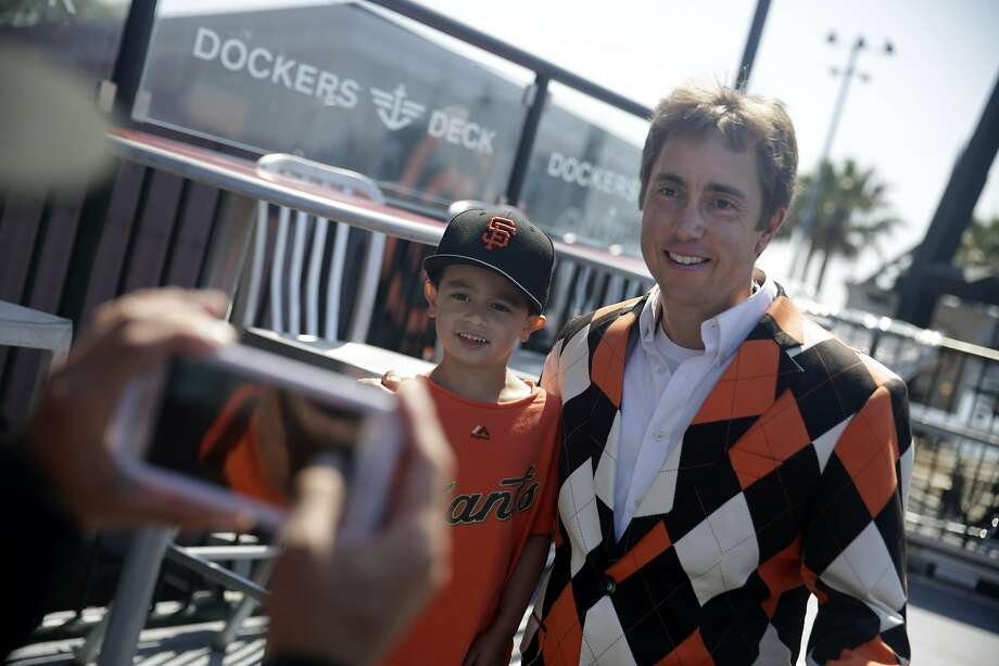 Giants ballpark organist Steve Hogan (right) poses for a picture with Giants' fan Taylor Dobie (left), 5, of Belmont as Sean Dobie (hands at far left bottom corner), father of Taylor, takes a photo before  the San Francisco Giants play the Pittsburgh Pirates at AT&T Park  on Wednesday, August 17,  2016 in San Francisco, California. Photo: Lea Suzuki, The Chronicle