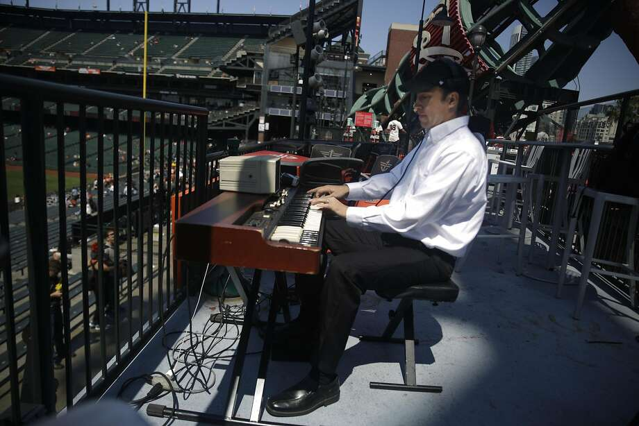 Steve Hogan plays the organ as fans arrive at AT&T Park for a Giants game against the Pittsburgh Pirates. Photo: Lea Suzuki, The Chronicle