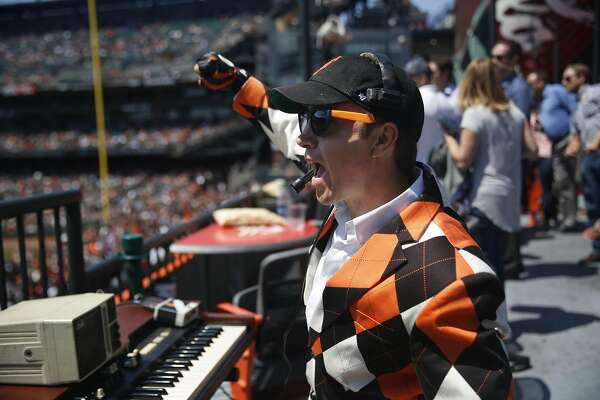 Giants ballpark organist Steve Hogan cheers for the Giants as the San Francisco Giants play the Pittsburgh Pirates as he works at AT&T Park  on Wednesday, August 17,  2016 in San Francisco, California.