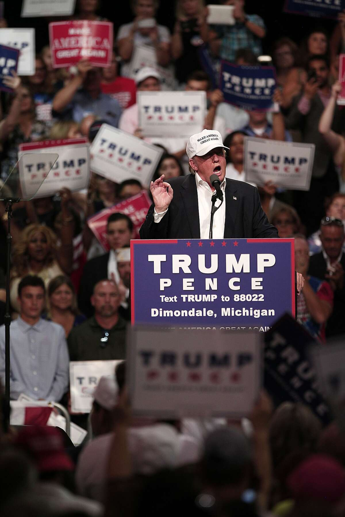 DIMONDALE, MI - AUGUST 19: Republican presidential nominee Donald Trump speaks at a campaign rally August 19, 2016 in Dimondale, Michigan. Earlier in the day, Trump toured flood-ravaged Louisiana. (Photo by Bill Pugliano/Getty Images)