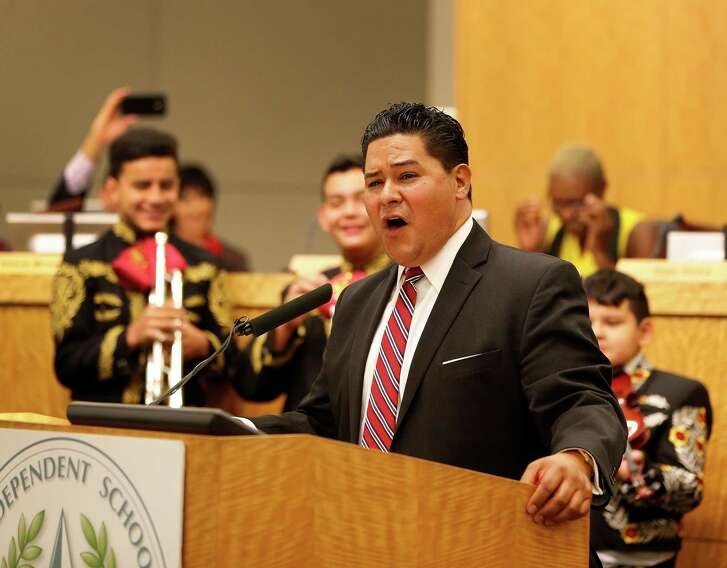 Richard Carranza sings with members of the Northside High School mariachi group who attended the Houston school board meeting Thursday to officially hire him as the superintendent. ( Karen Warren  / Houston Chronicle )