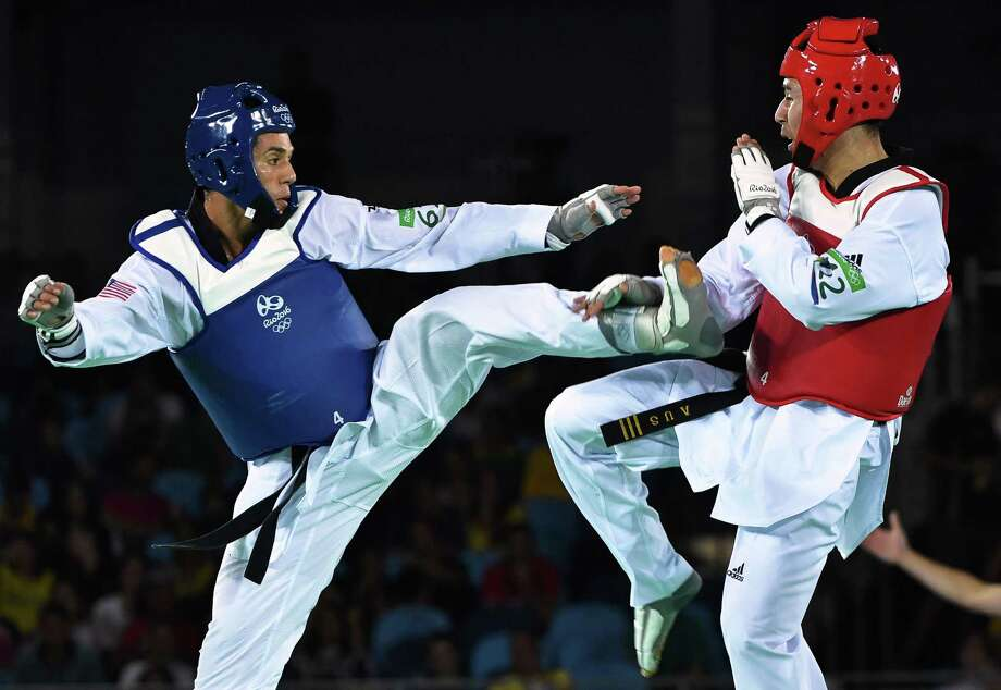 US Steven Lopez (L) competes against Australia's Hayder Shkara during their men's taekwondo repechage bout in the -80kg category as part of the Rio 2016 Olympic Games, on August 19, 2016, at the Carioca Arena 3, in Rio de Janeiro.  / AFP PHOTO / Ed JONESED JONES/AFP/Getty Images Photo: ED JONES, AFP/Getty Images / AFP or licensors