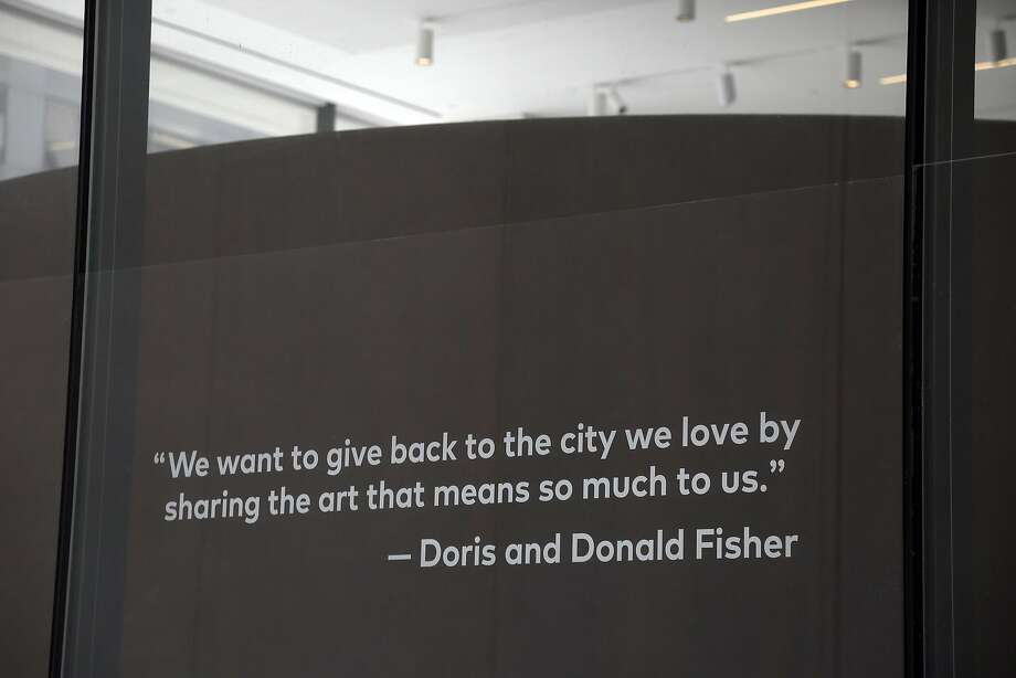 A quote from Doris and Donald Fisher is seen on a window near the entrance on Howard Street of the newly expanded San Francisco Museum of Modern Art in April. Photo: Eric Risberg, Associated Press