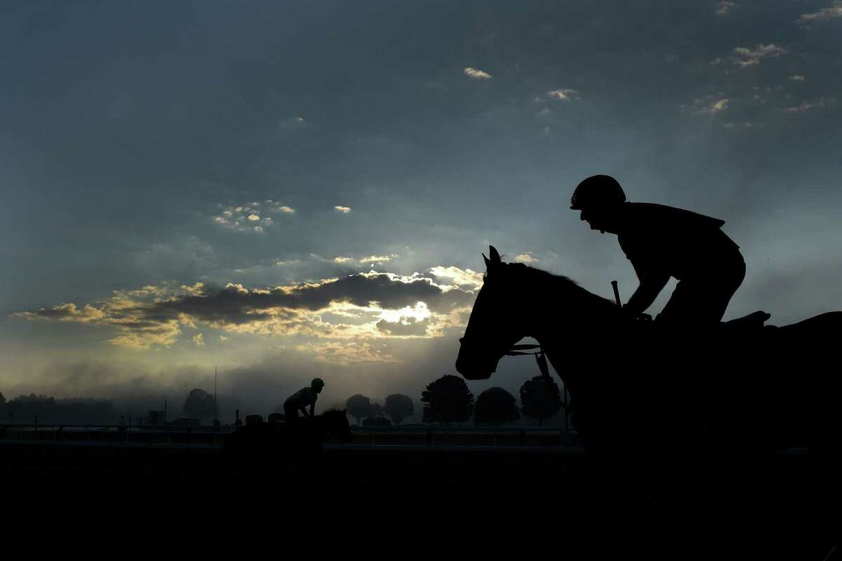 A beautiful morning with a mixture of light fog and cloud cover as horses exercise at the Saratoga Race Course on Friday, Aug. 19, 2016, in Saratoga Springs, N.Y. (Skip Dickstein/Times Union)