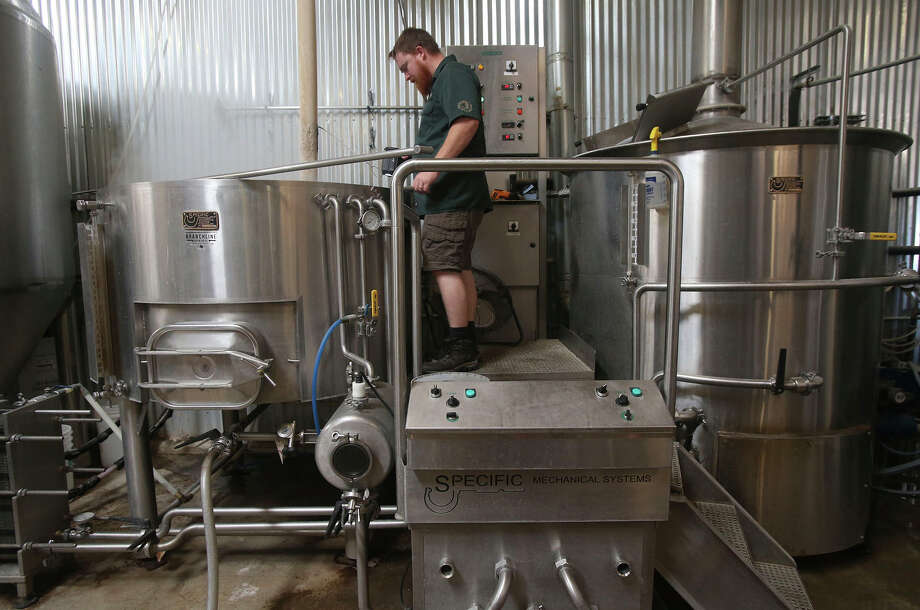 Branchline Brewing Company head brewer Paul Ford checks the mash Friday July 29, 2016 while making the company's Shady Oak brand of beer. The company has six brands of beer that it makes throughout the year as well as some seasonal brands. Located off of Wetmore Road at 3633 Metro Parkway, the company has a tap room for sampling its beer that's open on Friday from 4:00 p.m. to 9:00 p.m. and on Saturday from 2:00 p.m. to 8:00 p.m. Photo: John Davenport /San Antonio Express-News / ©San Antonio Express-News/John Davenport