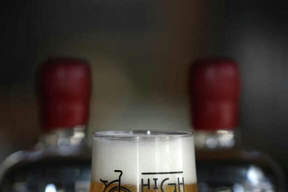 A glass of Saison, a farmhouse style ale, sits on the bar at the Dorcol Distilling Company, Thursday, August 4, 2016. A judge ruled Thursday that a Texas law that prohibits craft brewers from selling their distribution rights is unconstitutional, serving up a major victory to independent beer companies seeking to expand their presence in stores, bars and restaurants throughout the state.