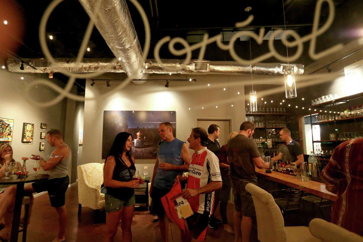 Customers enjoy a drink at Dorcol Distilling + Brewing Co.