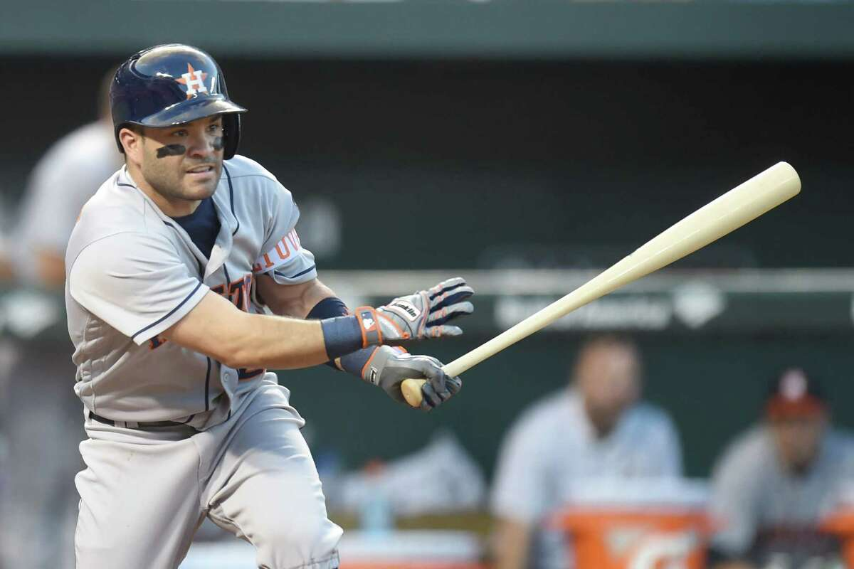 BALTIMORE, MD - AUGUST 19: Jose Altuve #27 of the Houston Astros singles in two runs in the second inning during a baseball game against the against the Baltimore Orioles at Oriole Park at Camden Yards on August 19, 2016 in Baltimore, Maryland.