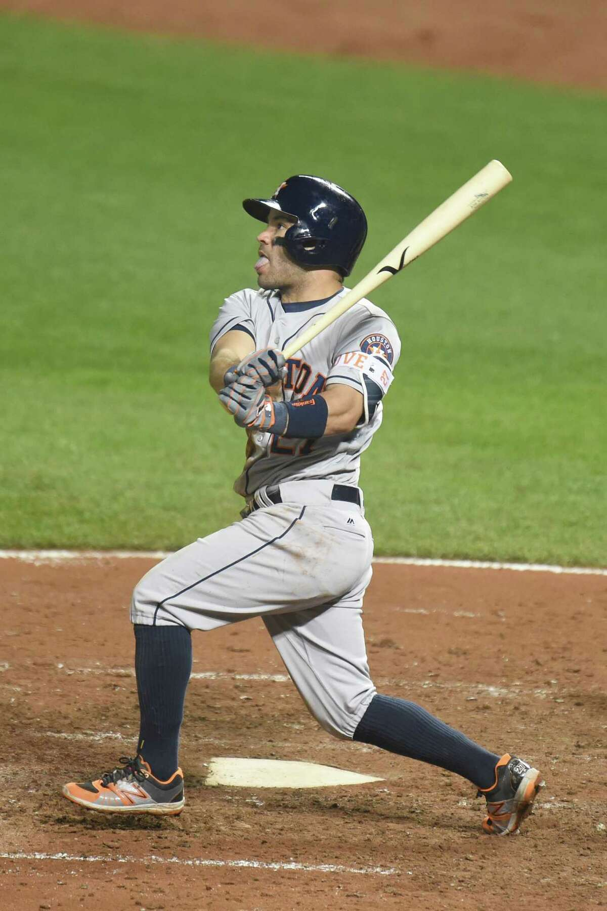 BALTIMORE, MD - AUGUST 19: Jose Altuve #27 of the Houston Astros hits a two run home run in the fifth inning during a baseball game against the the Baltimore Orioles at Oriole Park at Camden Yards on August 19, 2016 in Baltimore, Maryland.