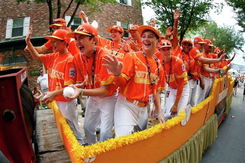 Members of the Regional Champion Little League team from San Antonio, Texas ride in the Little League Grand Slam Parade in downtown Williamsport, Pa., Wednesday, Aug. 17, 2016. The Little League World Series tournament gets underway, Thursday, Aug, 18, 2016 in South Williamsport, Pa.. AP Photo/Gene J. Puskar).