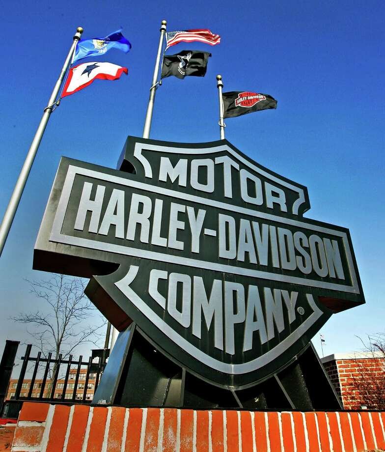 FILE - In this Jan. 18, 2006 file photo, a sign stands outside the corporate offices of Harley Davidson in Milwaukee. Harley-Davidson has agreed to pay $15 million to settle a complaint filed by federal environmental officials over racing tuners that caused its motorcycles to emit higher than allowed levels of air pollution. (AP Photo/Morry Gash, File) Photo: MORRY GASH, STF / AP2006