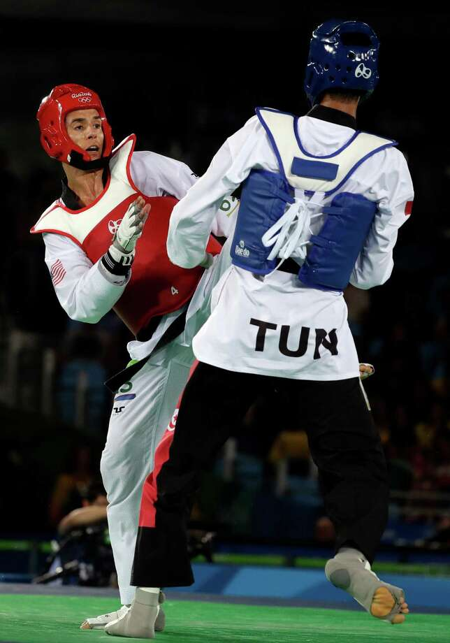 Tunisia's Oussama Oueslati, right, defeated Sugar Land native Steven Lopez 14-5 on Friday in one of two bronze-medal matches in the men's taekwondo welterweight division. Photo: Andrew Medichini, STF / Copyright 2016 The Associated Press. All rights reserved. This material may not be published, broadcast, rewritten or redistribu
