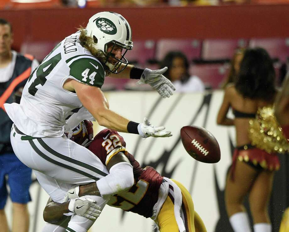 d26903a6e22 New York Jets tight end Zach Sudfeld (44) fumbles the ball as he is