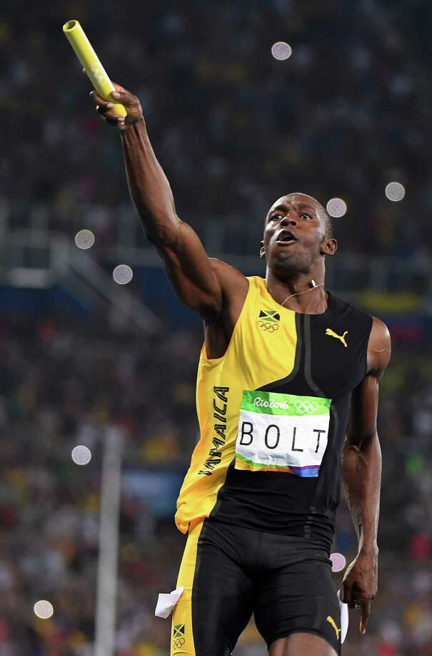 Usain Bolt completes his historic golden triple-triple by anchoring the Jamaican team to victory in the 400-meter relay Friday night at Olympic Stadium in Rio de Janeiro. Photo: OLIVIER MORIN, Staff / AFP or licensors