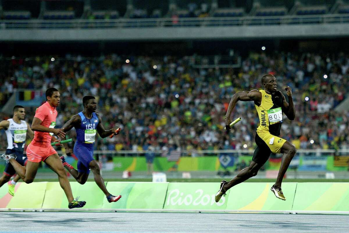 Usain Bolt proved that starting his anchor leg perhaps a step behind Japan's Aska Cambridge, left, and American Trayvon Bromell, center, was not a problem by the time he hit the finish line.