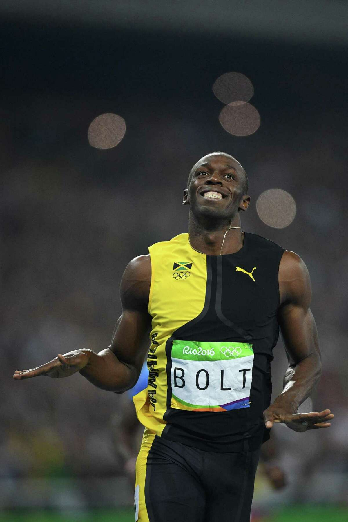 Jamaica's Usain Bolt celebrates after he won the Men's 100m Final during the athletics event at the Rio 2016 Olympic Games at the Olympic Stadium in Rio de Janeiro on August 14, 2016. / AFP PHOTO / Johannes EISELEJOHANNES EISELE/AFP/Getty Images