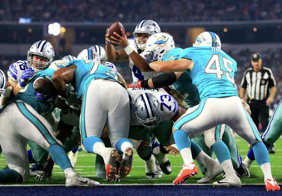 Cowboys rookie quarterback Dak Prescott, center top, fights to get over the line of scrimmage to score one of his two rushing touchdowns Friday night. Photo: Ron Jenkins, FRE / FR171331 AP