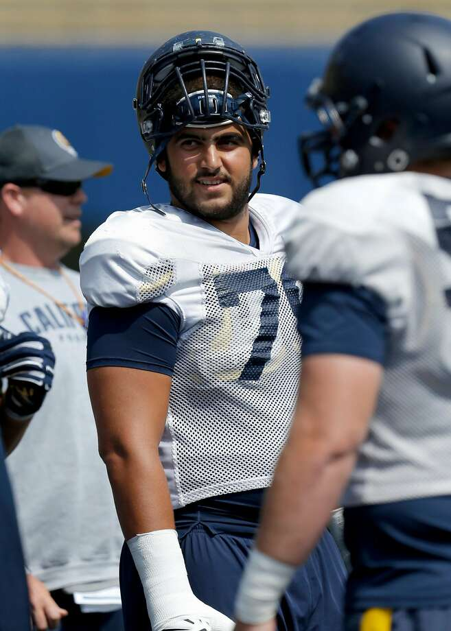 Offensive lineman Patrick Mekari, 79 during warm ups as the  Cal Bears football team holds practice at Memorial Stadium in Berkeley, California, on Fri. Aug. 19, 2016. Photo: Michael Macor, The Chronicle