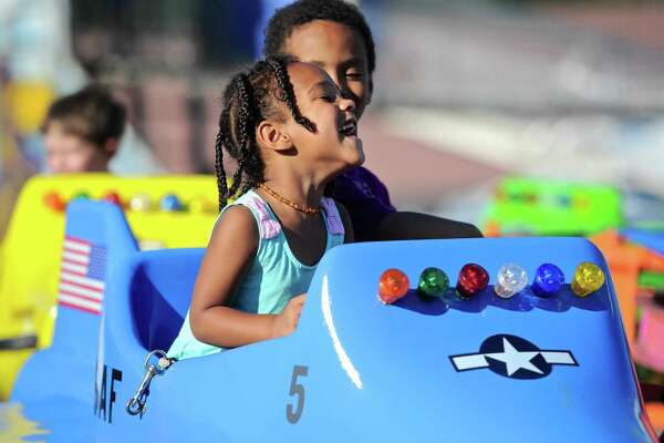 Olivia Allen, 3, and her brother Steven fly around on a carnival rides at  the Bridgewater Country Fair, Friday, August 19, 2016, in Bridgewater, Conn.