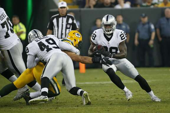 Oakland Raiders running back Latavius Murray (28) runs against the Green Bay Packers during the first half of an NFL preseason football game in Green Bay, Wis., Thursday, Aug. 18, 2016. (AP Photo/Mike Roemer)