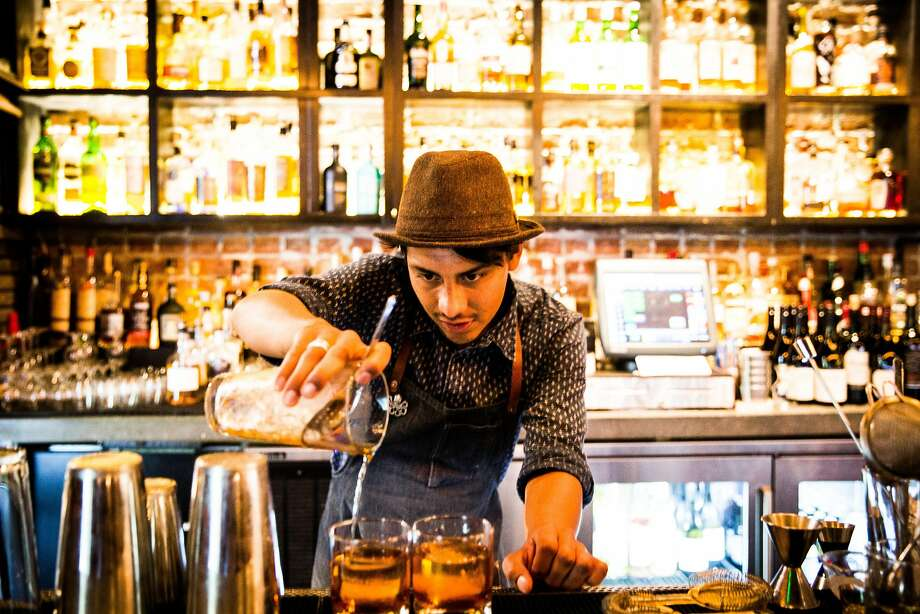 Luis Ledezma makes Old Fashioned cocktails at the Block Butcher Bar at Lowbrau in Midtown Sacramento. Photo: Max Whittaker/Prime, Special To The Chronicle