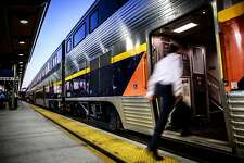 Joseph Barjis boards Amtrak's Capitol Corridor train in downtown Sacramento, California on August 16, 2015.