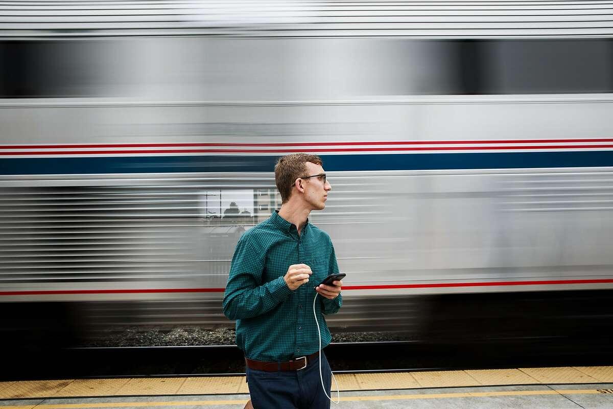 Scott Sellers waits for Amtrak's Capitol Corridor train in Richmond, California on August 16, 2015.