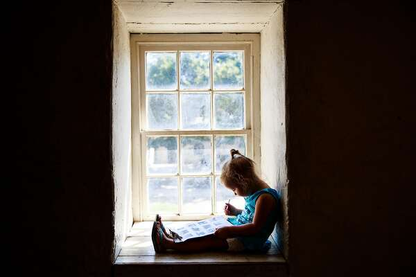 Audrey Hooker, 5, works on a historical activity sheet at Sutter's Fort in Sacramento, California on August 17, 2015.