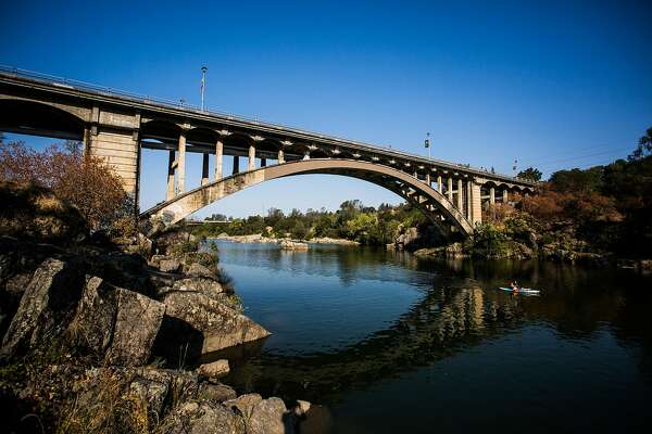 The Rainbow Bridge stretches over Lake Natoma near the Folsom Powerhouse in Folsom, California on August 18, 2015.