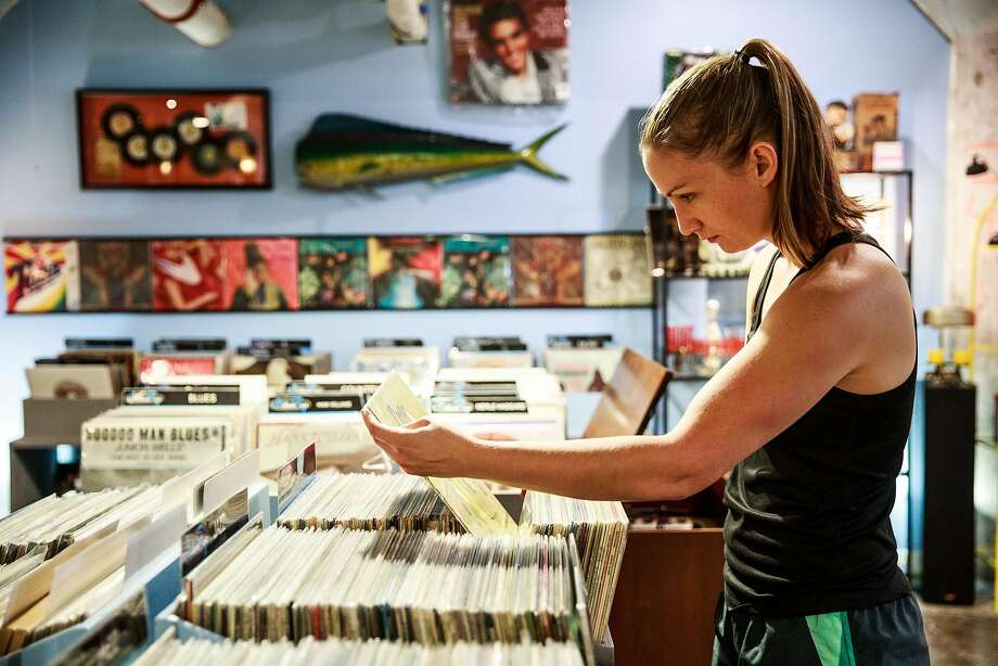 Erin Osiecki shops for vinyl at Kicksville Vinyl & Vintage in the Warehouse Artists Lofts Public Market in Sacramento, Calif. The lofts are just one of the suggested stops on this tour of Sacramento. Photo: Max Whittaker/Prime, Special To The Chronicle