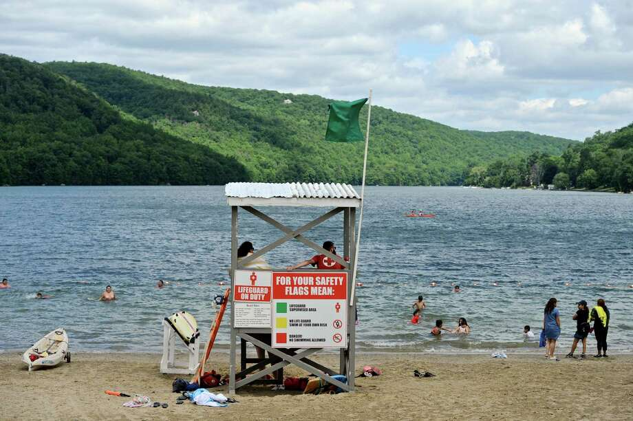 Life guards keep an eye on the swimmers at Squantz Pond State Park, in New Fairfield, on the first day of the Forth of July Holiday weekend. Saturday, July 2, 2016, in New Fairfield, Conn. Photo: H John Voorhees III / Hearst Connecticut Media / The News-Times