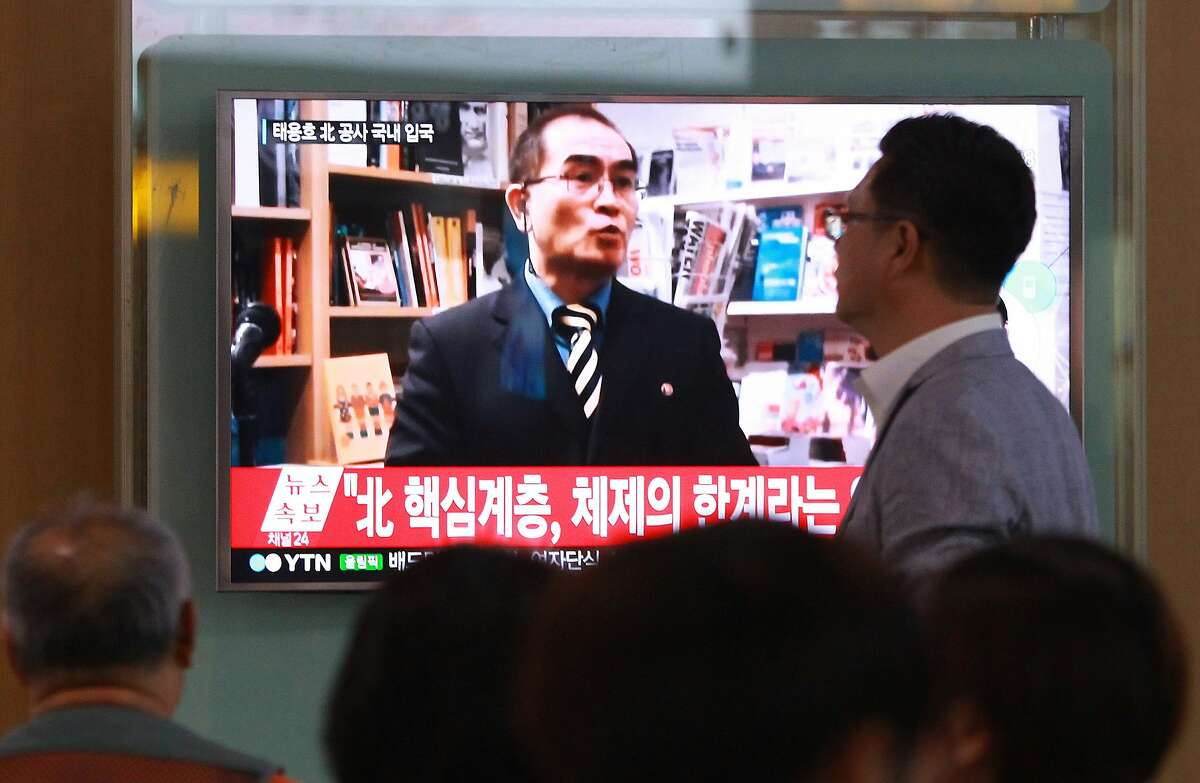 FILE - In this Wednesday, Aug. 17, 2016 file photo, people watch a TV news program showing a file image of Thae Yong Ho, a minister at the North Korean Embassy in London, at Seoul Railway Station in Seoul, South Korea. North Korea on Saturday, Aug. 20, 2016, said Thae, a senior North Korean diplomat who recently defected to South Korea, is a criminal and