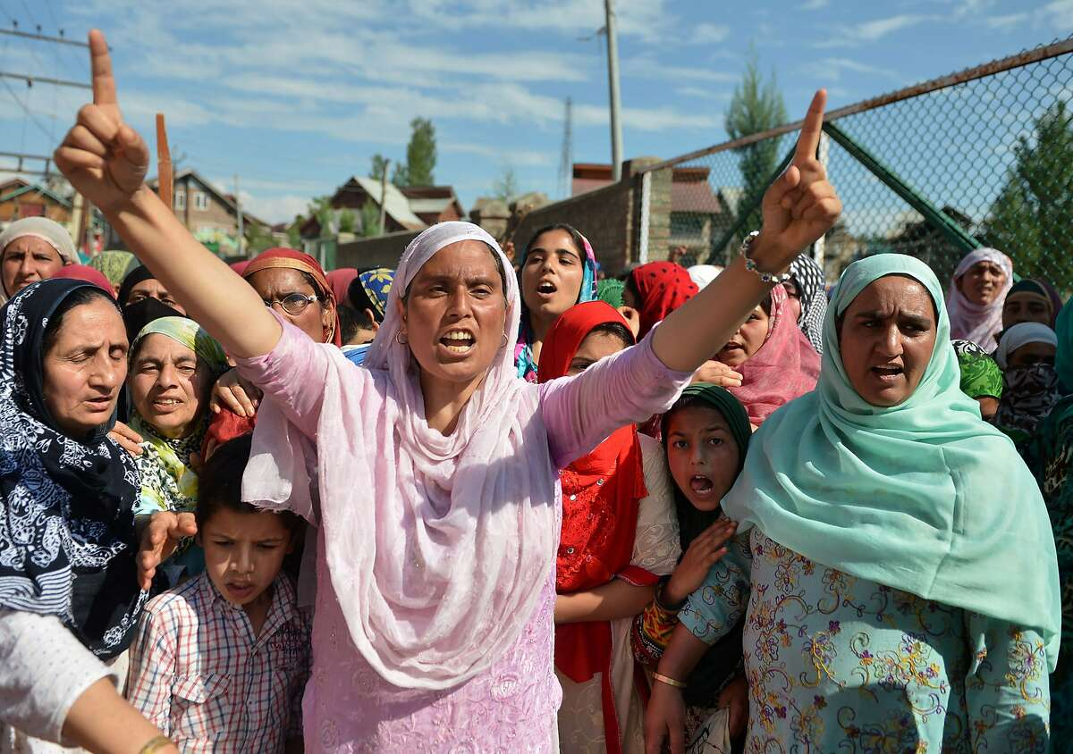 Kashmiri protestors shout pro-freedom and antI-Indian slogans during a protest in Srinagar on August 19, 2016. Indian-administered Kashmir has been in the grip of almost daily anti-India protests and rolling curfews sparked by the killing on July 8 of a popular rebel leader, Burhan Wani, in a gunfight with government forces. / AFP PHOTO / TAUSEEF MUSTAFATAUSEEF MUSTAFA/AFP/Getty Images