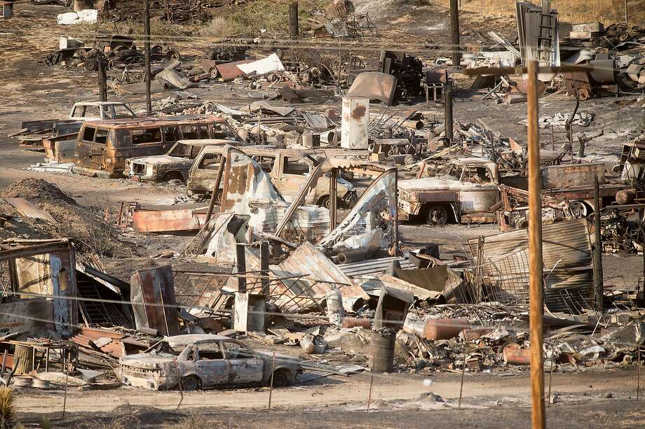 Scorched cars and trailers destroyed by the Blue Cut fire line a street in Phelan (San Bernardino County). The fire was 68 percent contained Saturday. Photo: Noah Berger, Associated Press