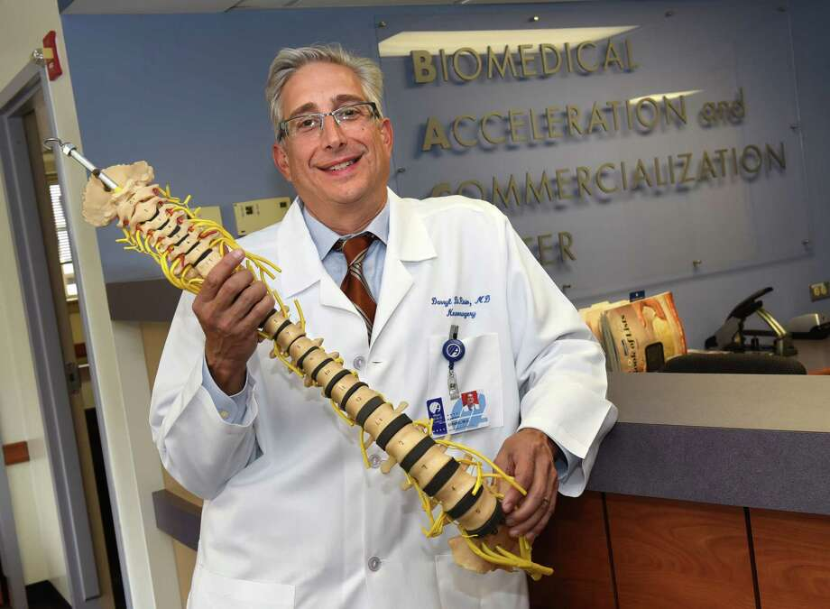 Dr. Darryl DiRisio neurosurgeon, department of neurosurgery, holds a ReVivo spine model at the Biomedical Acceleration Commercialization Center at Albany Medical Center on Thursday, Aug. 18, 2016 in Albany, N.Y. (Lori Van Buren / Times Union) Photo: Lori Van Buren / 20037694A