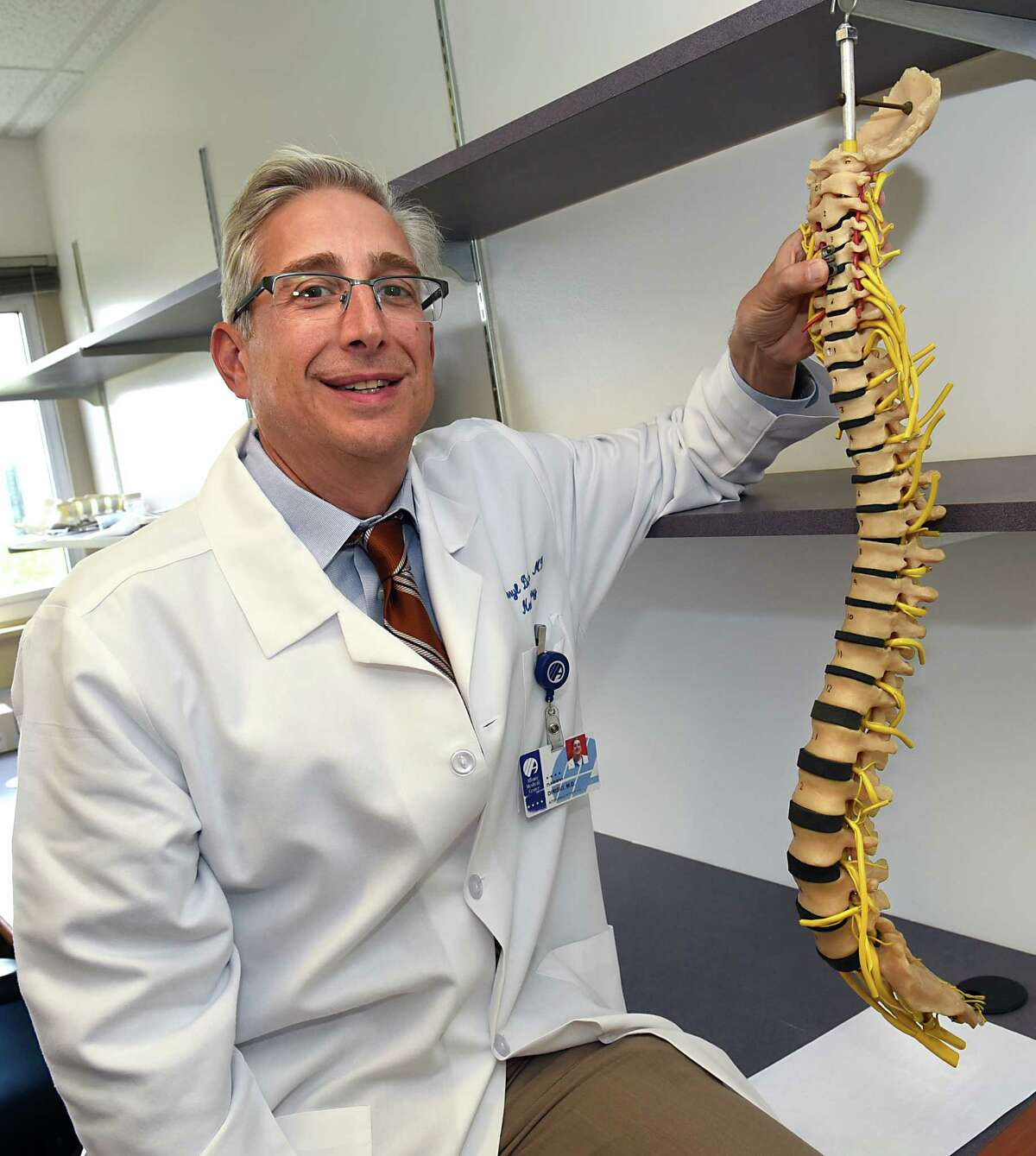 Dr. Darryl DiRisio neurosurgeon, department of neurosurgery, holds a reveal device on a ReVivo spine model at the Biomedical Acceleration Commercialization Center at Albany Medical Center on Thursday, Aug. 18, 2016 in Albany, N.Y. (Lori Van Buren / Times Union)