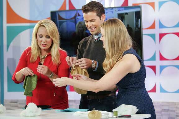 Houston Life hosts Jennifer Broome, left, and Derrick Shore, center, talk to blogger Amber Oliver about fall crafts during the first day of filming at KPRC's new daytime television show at their studio in the Galleria.