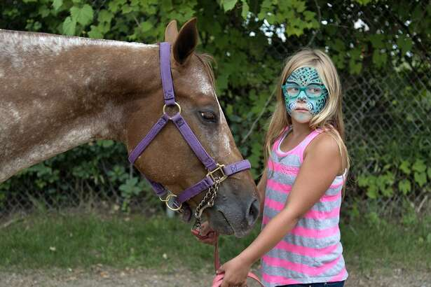 "Adela Christiansen, 8, of Midland is showing her pony, 6-year-old Sassy, for the first time at this year's fair. ""I'm showing her in costume, walk trot and halter,"" Adela said. ""I think she'll do good as long as she doesn't get too antsy."""