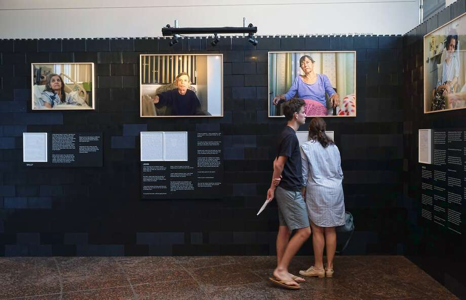 Visitors tour a photo exhibit by Andrew George at the Museum of Tolerance in Los Angeles. The exhibit will run till Sept. 30. Photo: Richard Vogel, Associated Press