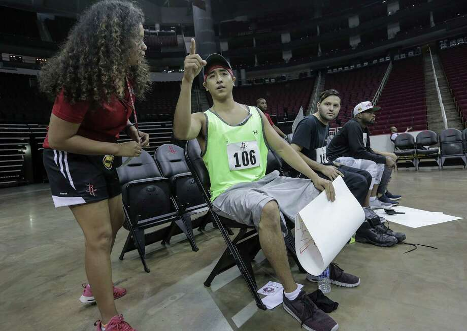 Dean Sivorakoune goes over instructions with an assistant for his 90-second routine during the open auditions for Clutch, the Houston Rockets mascot, at the Toyota Center on Saturday, Aug. 20, 2016, in Houston. Photo: Elizabeth Conley, Houston Chronicle / © 2016 Houston Chronicle